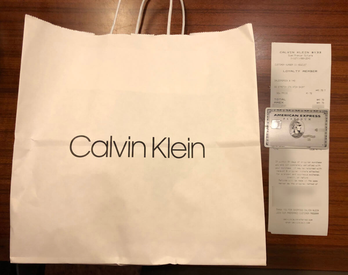 アメックスプラチナで購入したCalvin Kleinの紙袋とレシート